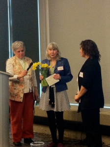 Belle and Carol presenting a thank you gift to Audriana for all the work she has contributed to CEFL.